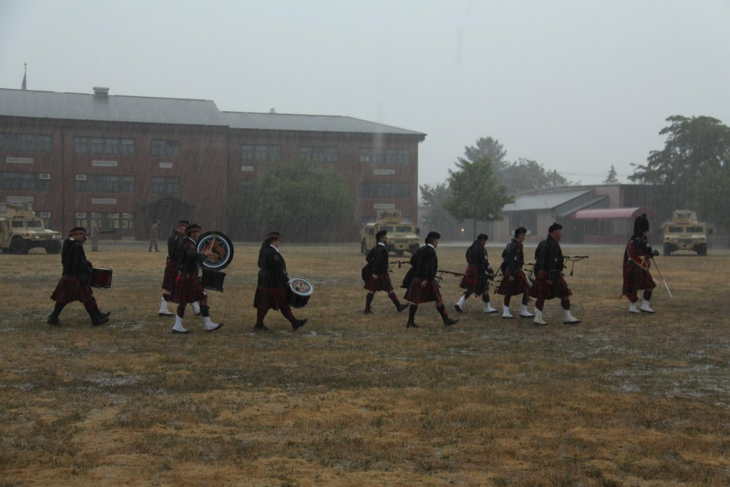 marching out to end the ceremony before the command, raining a bit harder