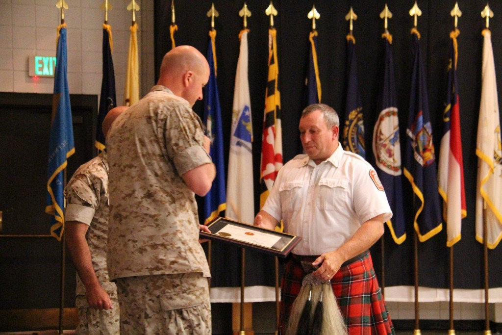 All dried off receiving Certificate of Appreciation from the Colonel